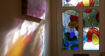Coloured Flowers front door panels with light on wall, leaded glass. Boddington