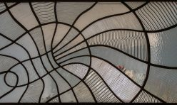 Hydra, internal window, of patterned clear glass. Boddington