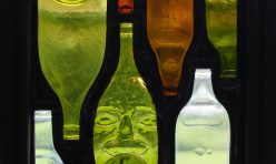 Face in the Crowd, leaded recycled-glass bottles. Boddington